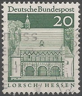 The gatehouse of Lorsch Abbey exemplifies classical inspiration for Carolingian architecture, built around 800 as a triple-arched hall, with the arcaded façade interspersed with engaged Corinthian columns and pilasters above. The apse-like structures on either side of the gatehouse recall the ancient Roman basilica. The abbey was the burial place for the king of East Francia, Ludovicus II, in 876.